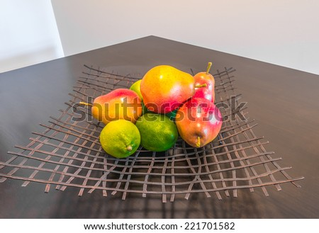 Some fruits pears and lemons on the decorative plate  Interior design. - stock photo