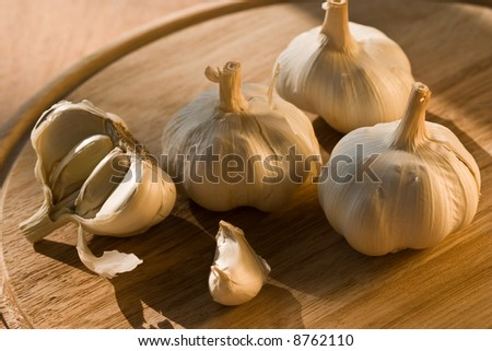 some garlic and chive garlic on the wooden board