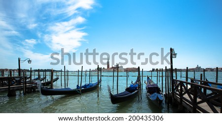 Some gondola at the water line in Venice - stock photo