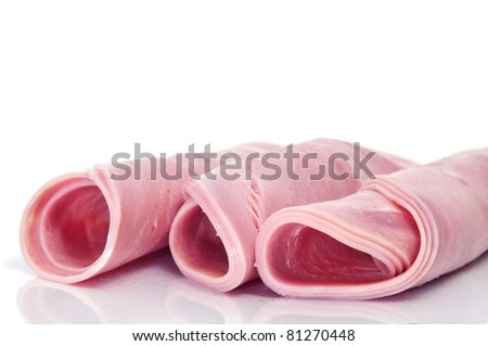 some ham rolls on a white background - stock photo