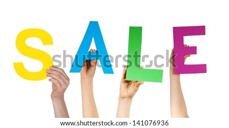some hands holding letters building the word sale, isolated