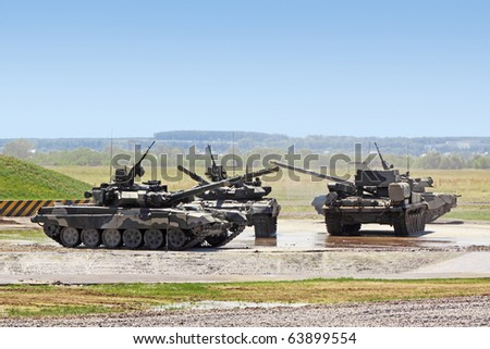Some heavy tanks in the field - stock photo
