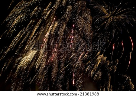 Some holiday fireworks on the night sky - stock photo