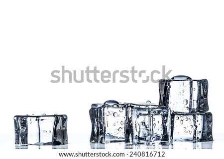 Some ice cubes on the water and white background - stock photo