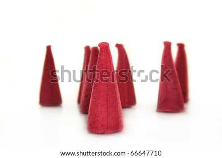 some incense candles on a white background