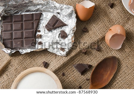 Some ingredients to make a chocolate cake - stock photo
