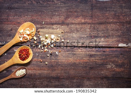 Some kind of spices in wooden spoon - stock photo