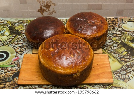some loaves of the baked bread lie on a table - stock photo