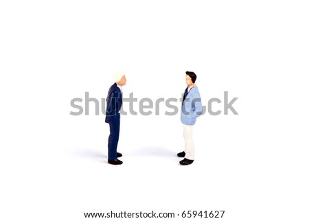 some miniature people fighting loud - stock photo