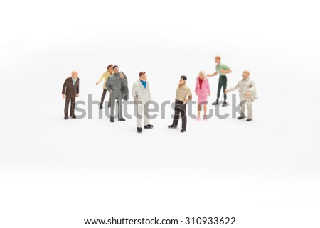 some miniature people or businessmen fighting loud - stock photo