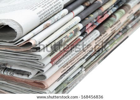 some newspapers on white background