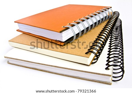 some notebooks with soft shadow on white background
