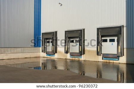 some numbered loading docks reflected in the water - stock photo