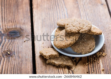 Some Oat Cookies on rustic wooden background (close-up shot) - stock photo