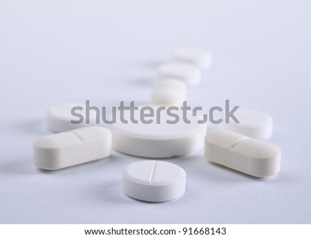 Some of White pills on a light background Shallow DOF