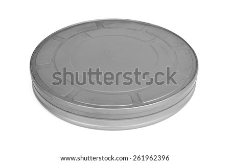 some old metal movie film reel canisters on a white background - stock photo