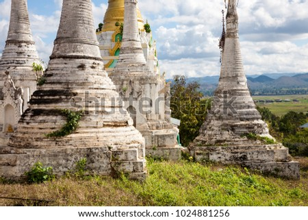Some old stupas on a hill in the south of the Inle Lake in the village of Thaung Tho in central Burma