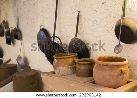 Some old utensils in an old and rural kitchen - stock photo