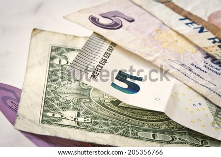 Some old worldwide currency small paper money and banknotes on a close up shot. - stock photo