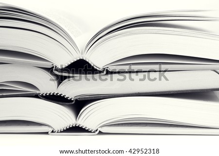 Some open big books in black and white - stock photo