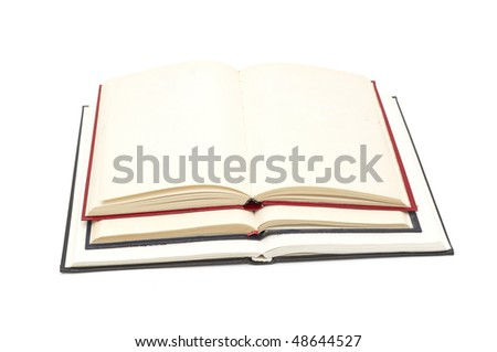 Some open big books isolated on white - stock photo