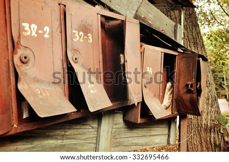 Some opened old rusty metal mailboxes - shallow depth of field, vintage filter processing - stock photo