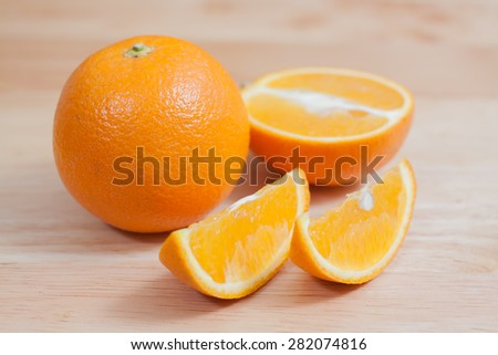 Some oranges over a wooden surface - stock photo