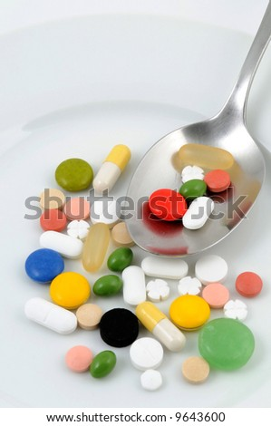 Some pills on a white plate - stock photo