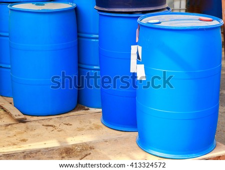 Some plastic blue barrels on a chemical plant - stock photo