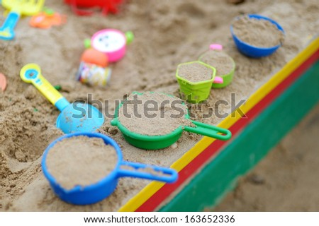 Some plastic sandbox toys - stock photo