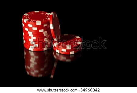 Some red casino chips - stock photo