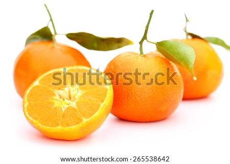 some ripe orange mandarin on white background - stock photo