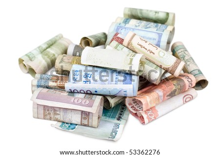 some rolled bank papers of different countries, clipping path - stock photo