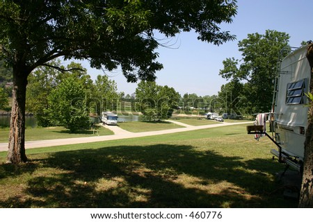 Some RV's parked at the lake for the weekend - stock photo
