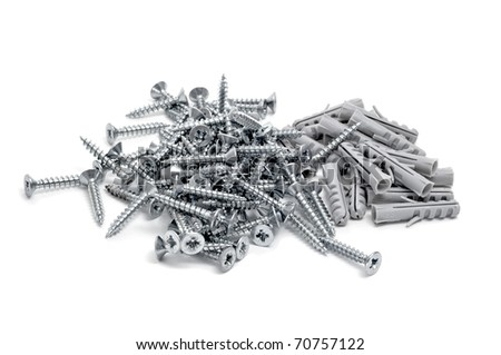 some screws and wall plugs isolated on a white background