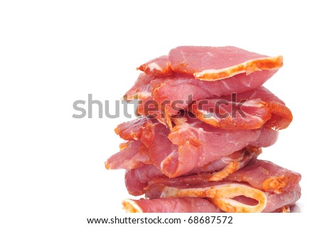 some slices of marinated tenderloin isolated on a white background - stock photo