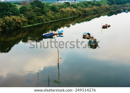 Some small fishing boat on the river - stock photo