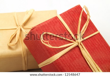 Some small gifts with bows from straw - stock photo