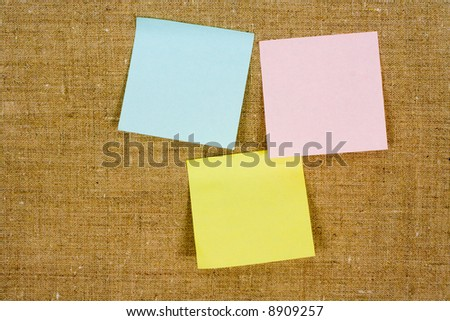 Some sticky leaflets, hanging on a canvas - stock photo