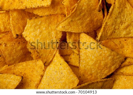 some tortilla chips forming a background pattern - stock photo