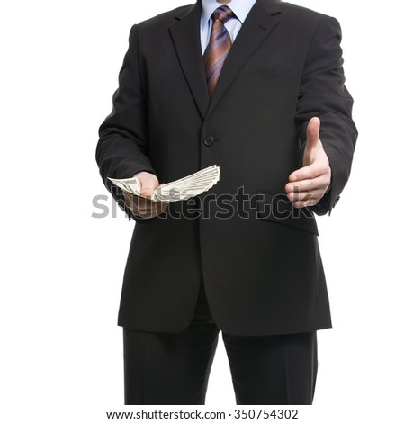 Some unrecognizable Businessman in dark suit shows a Spread of 100 American Dollars banknotes and offers a handshake, symbolizing Success, Business offer, Deal. Isolated on white background. - stock photo