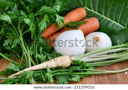 Some vegetables, green, white and orange, on wooden background, close up view - stock photo