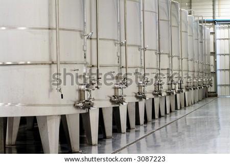 some wine metallic fermentation tanks - stock photo