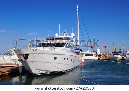 Some yachts in port on a trick - stock photo