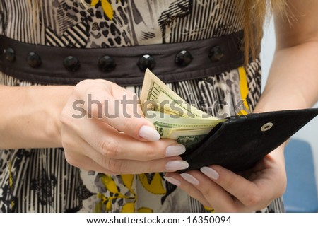 Someone count dollars - stock photo