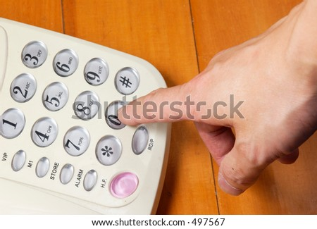 someone dialling a telephone - stock photo