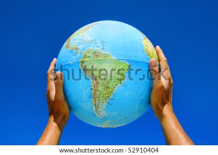someone holding a globe in his hands