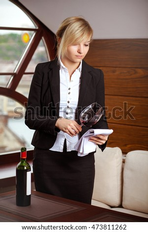 sommelier, beautiful girl in the restaurant tasting red wine