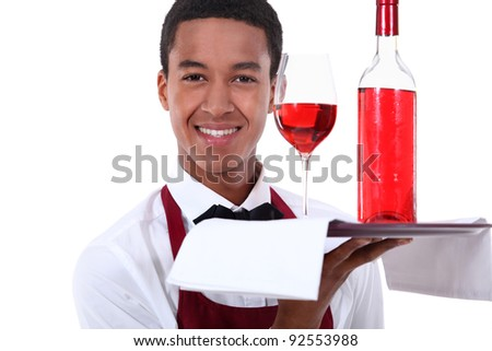 Sommelier serving a rose wine - stock photo