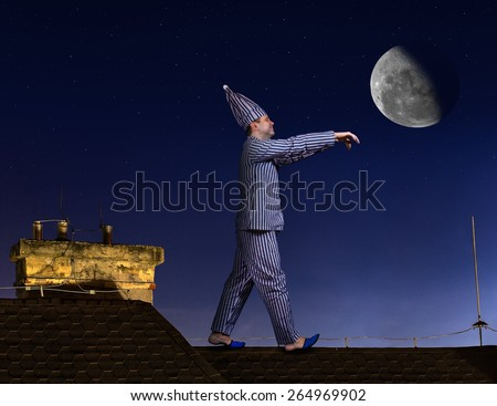 somnambulist walking on the roof on a background of the night sky with the moon - stock photo